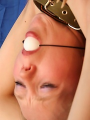 Bound slave girl gets clothespins all over her body
